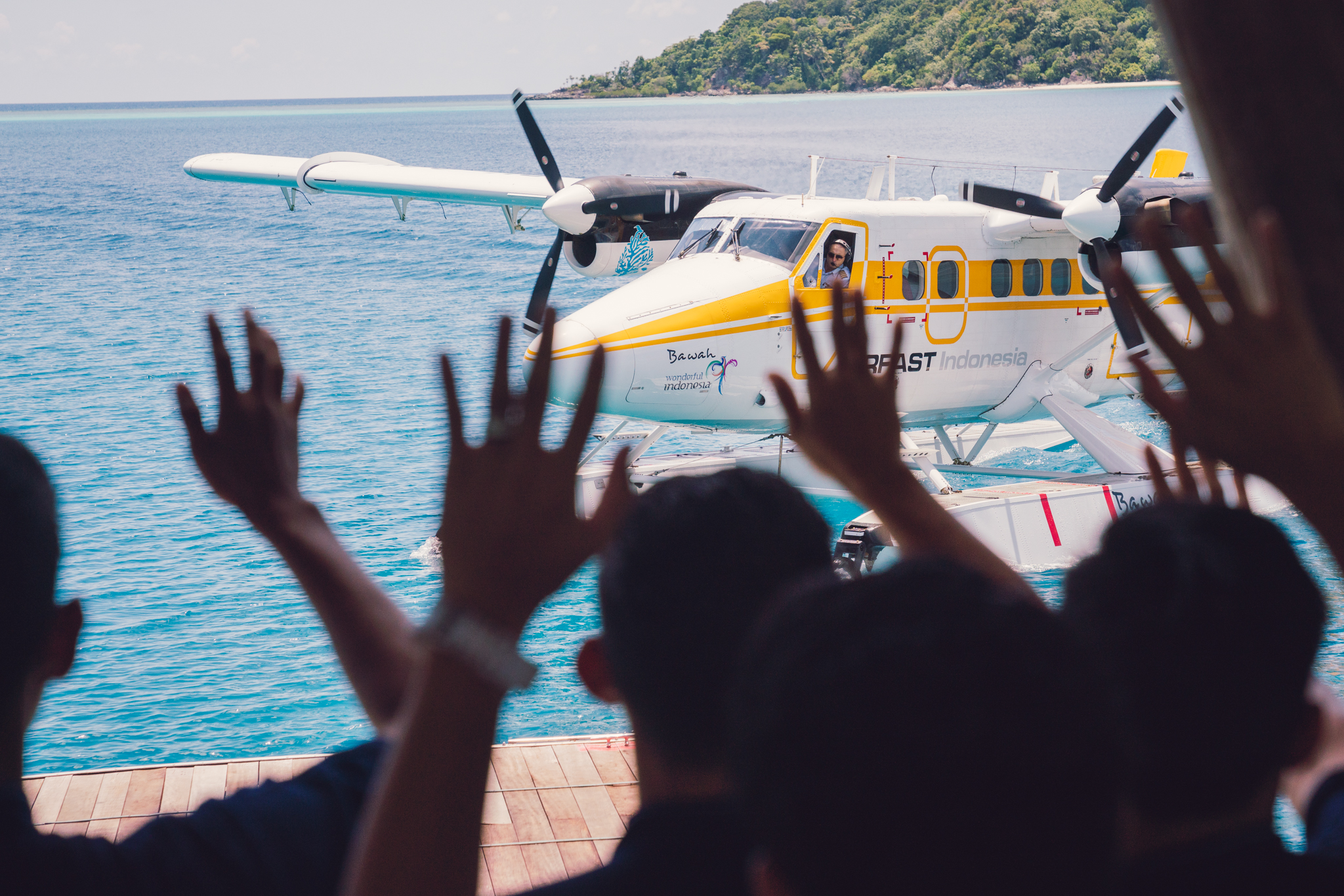 Waving off goodbye to seaplane staff