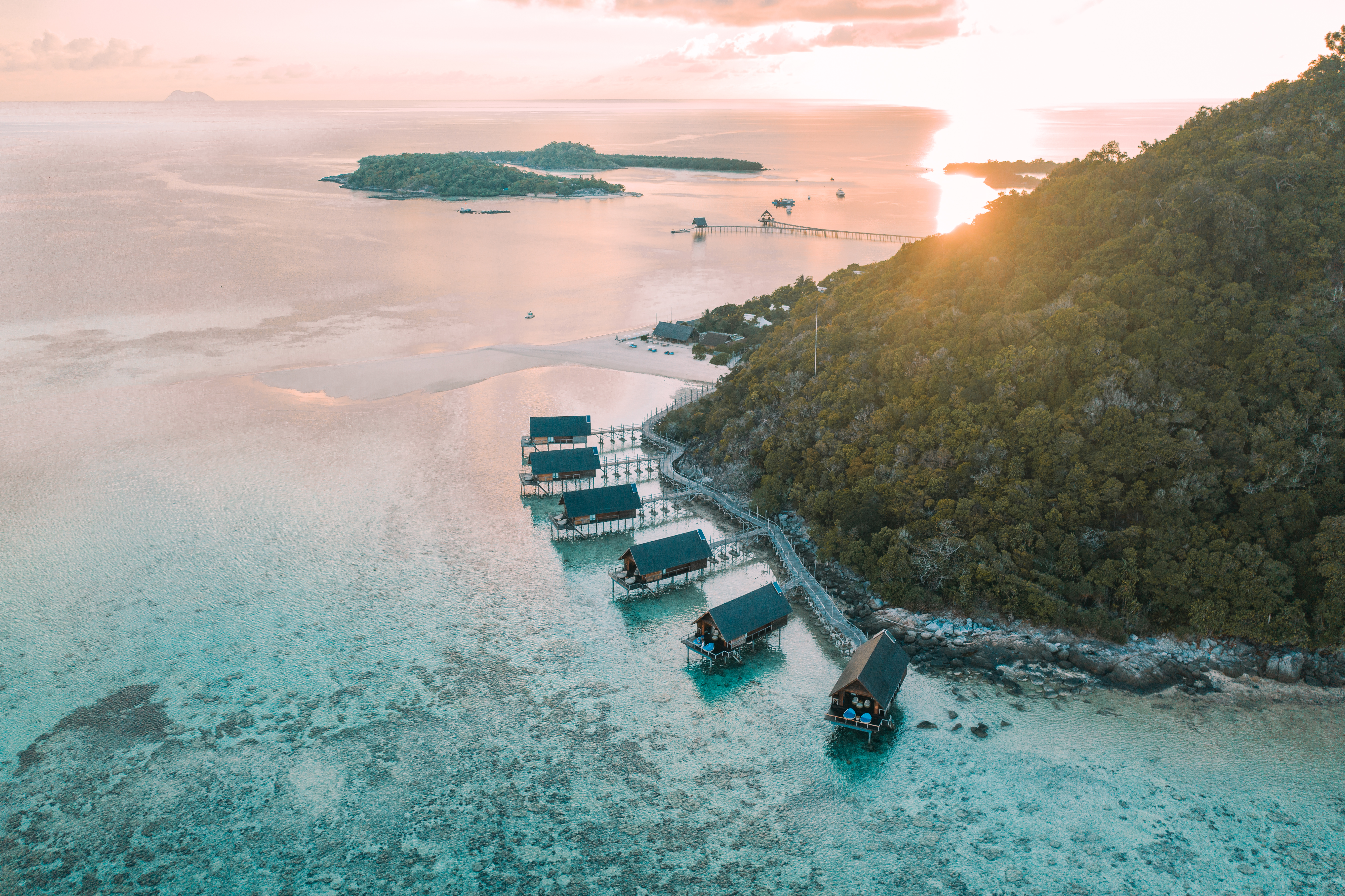 aerial_east_overwater_suites_at_sunset_with_elang_and_lidi_background