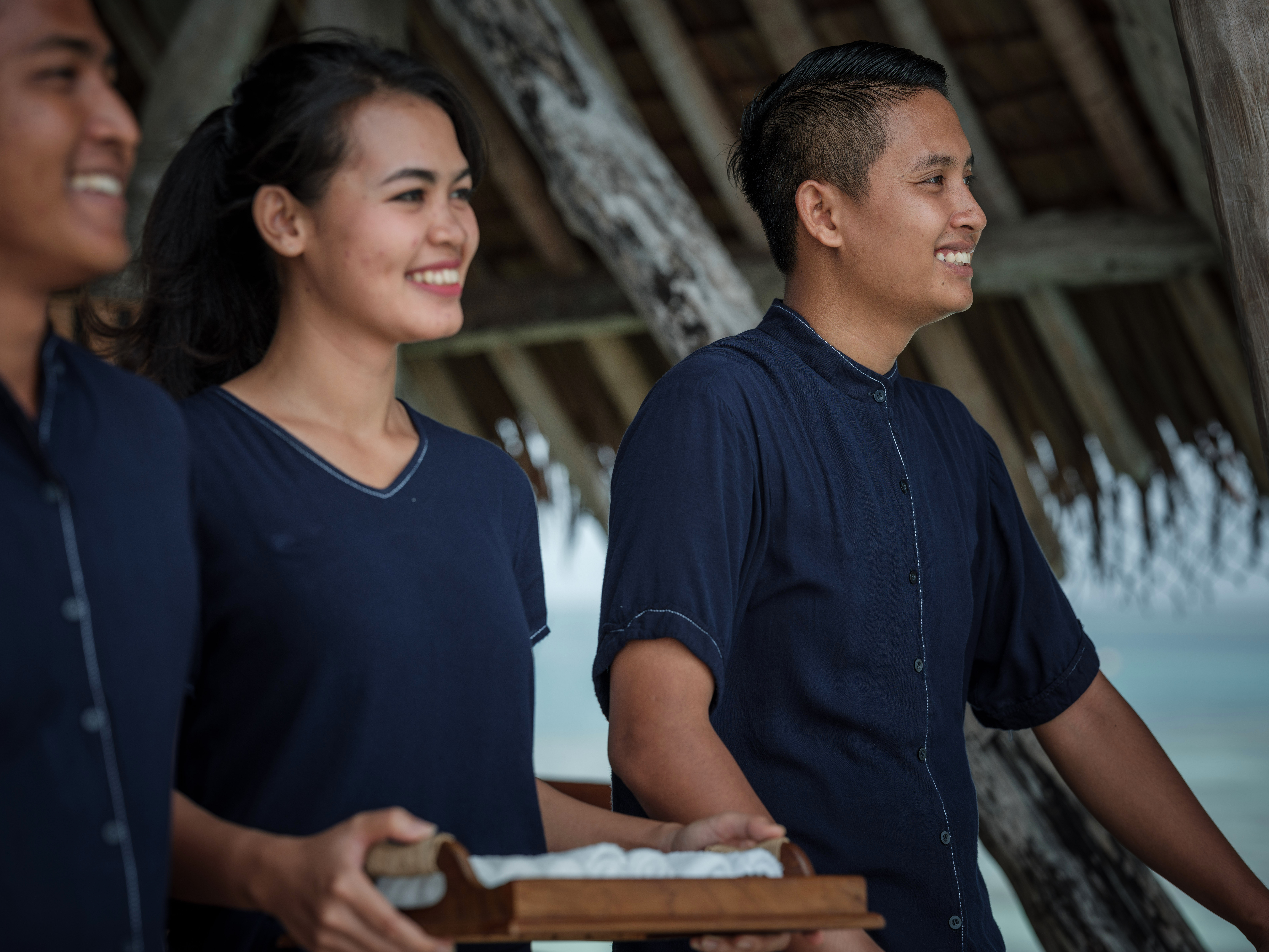 smiling_males_female_staff_holding_towel_tray_bawah_uniform_standing_at_jetty (2)-jpg