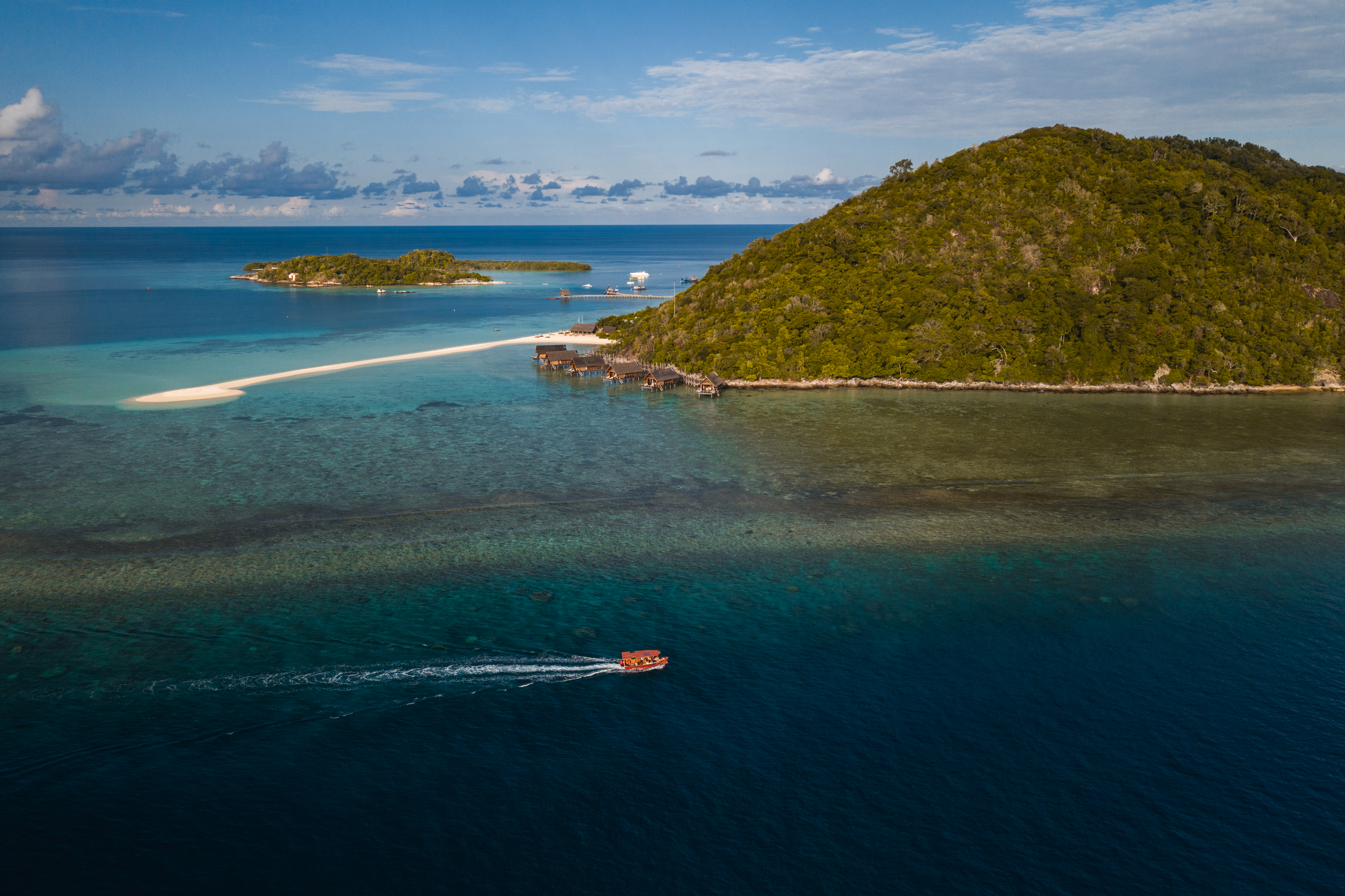 aerial-view-sunset-boat-trip-in-blue-lagoon-islands-background