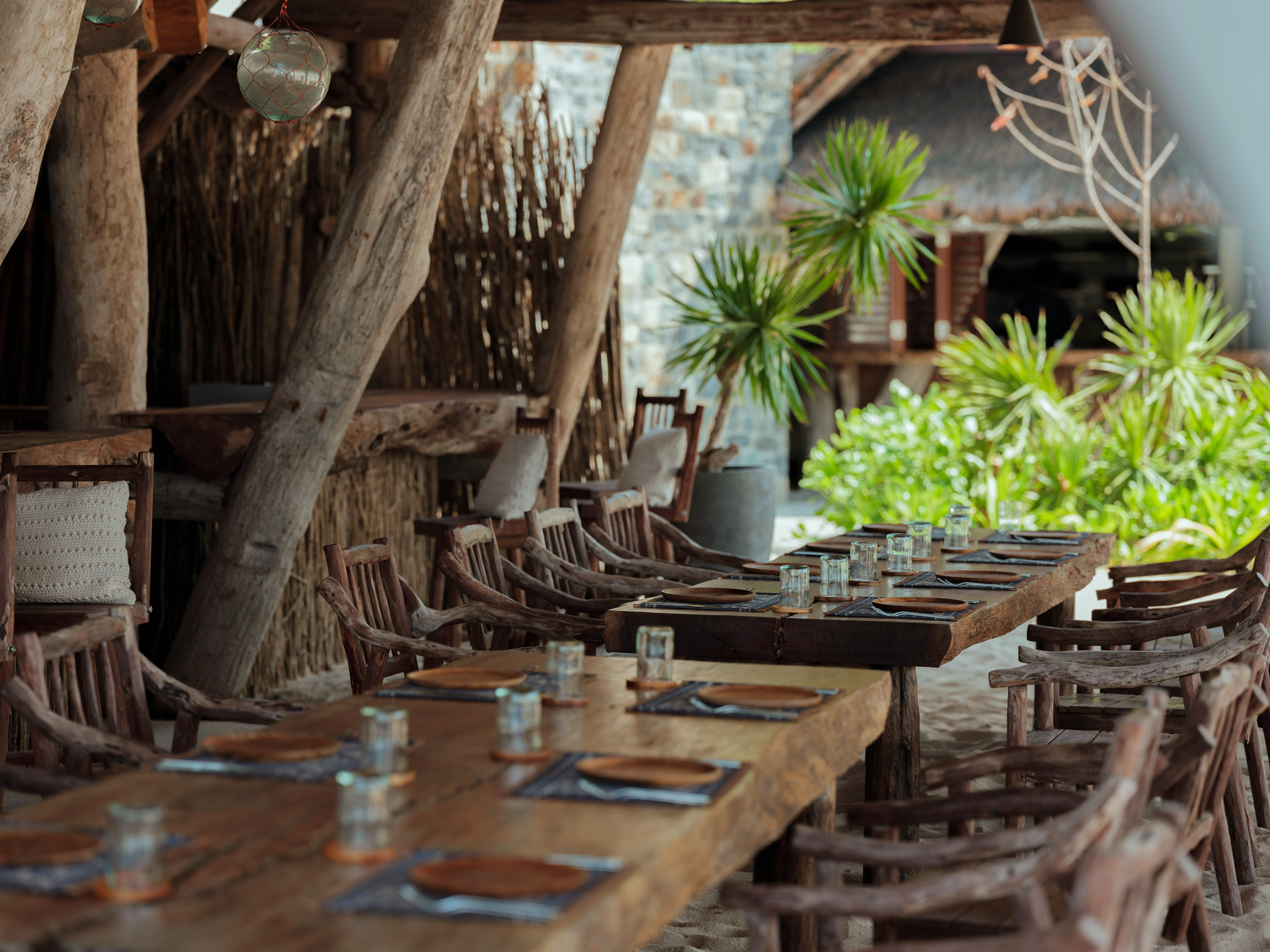 close_up_wooden_tabllle_arm_chairs_set_up_boat_house