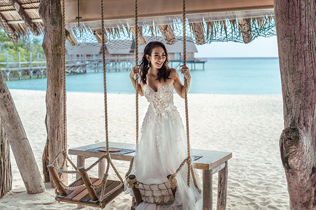 bride-in-wedding-dress-on-swing-at-boathouse-copy