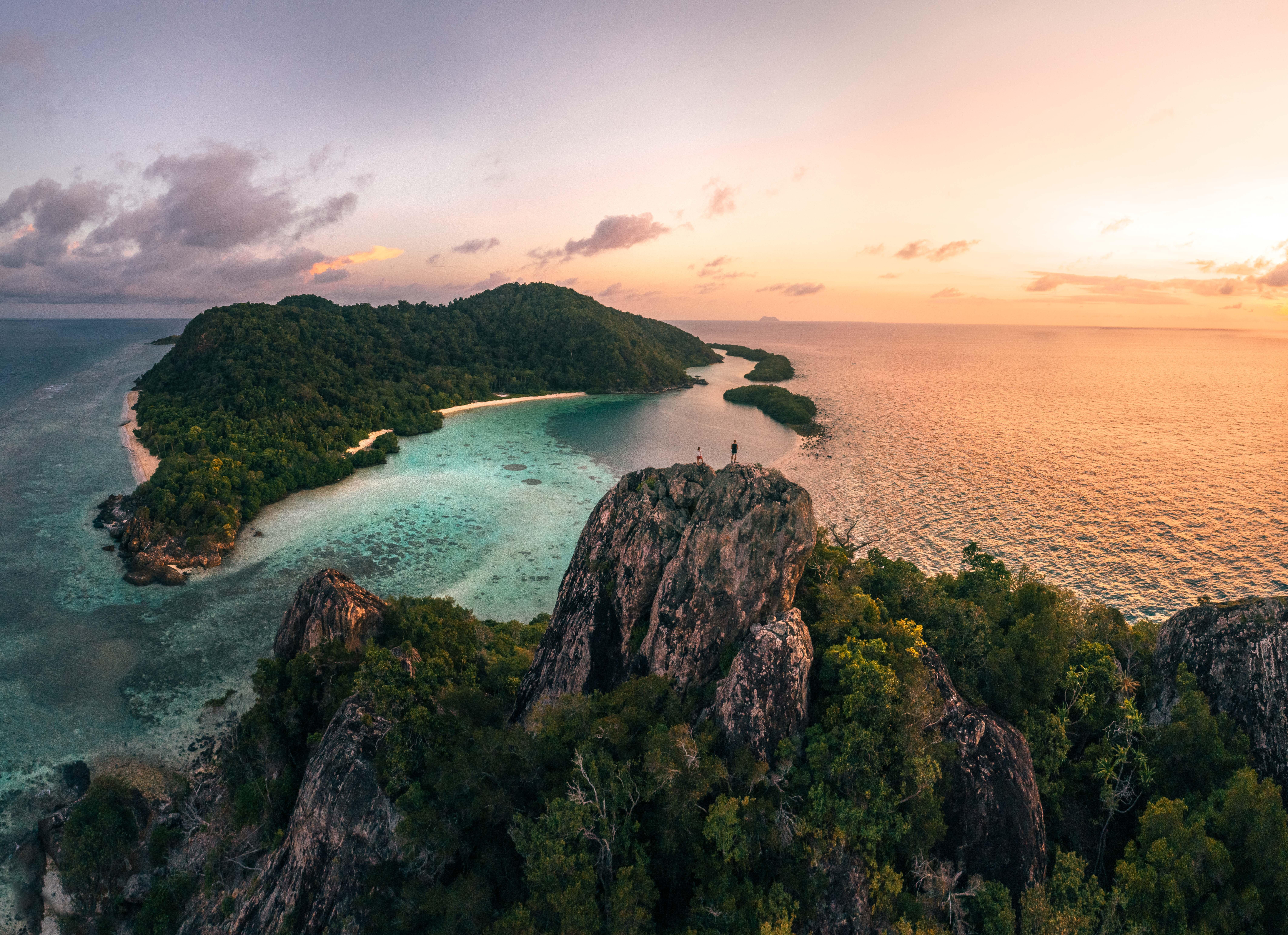 aerial_batu_tokong_close_up_in_distance_coconut_beach (1)