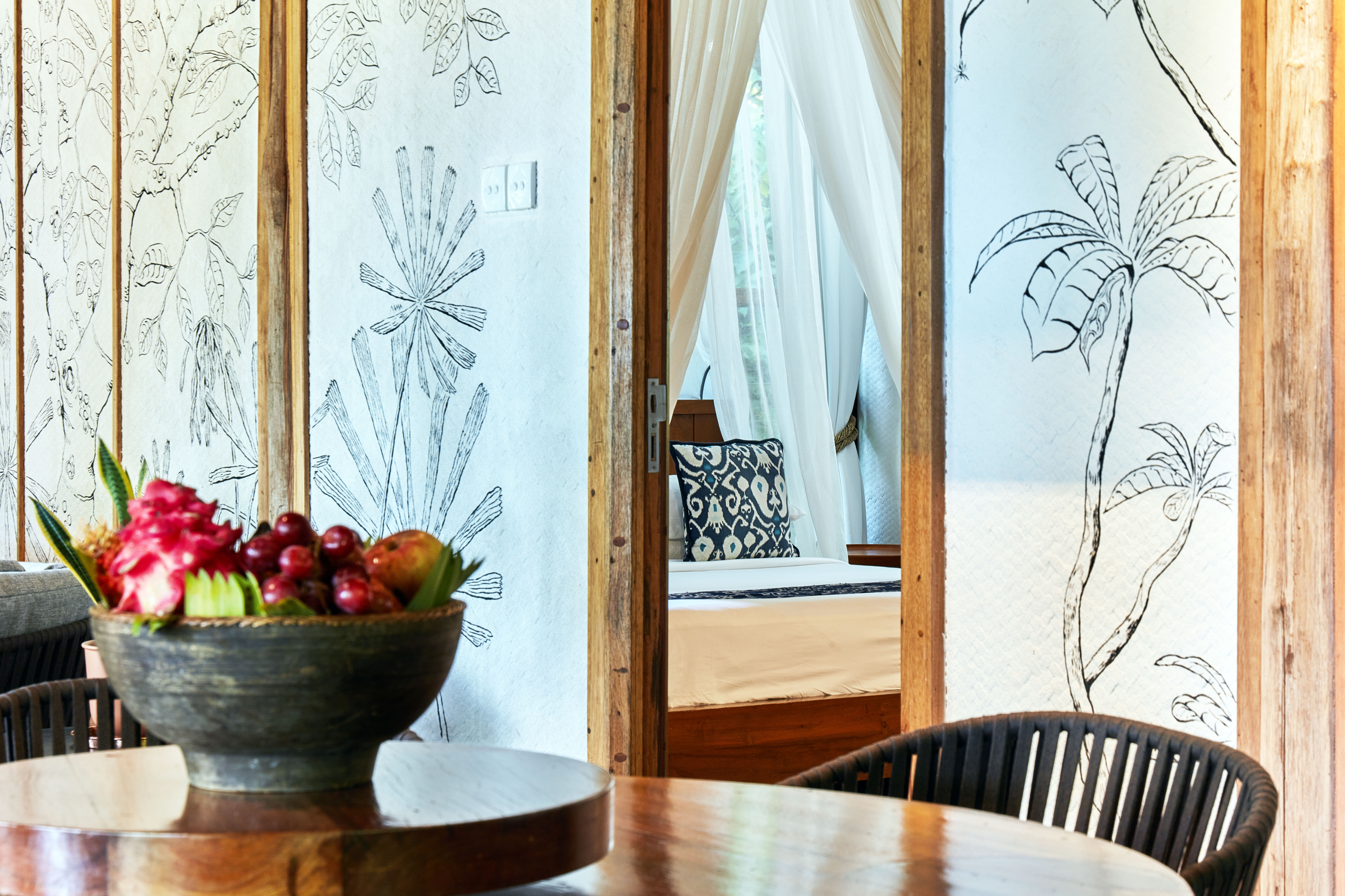 cropped_table_fruit_bowl_mural_wall_jungle_lodge
