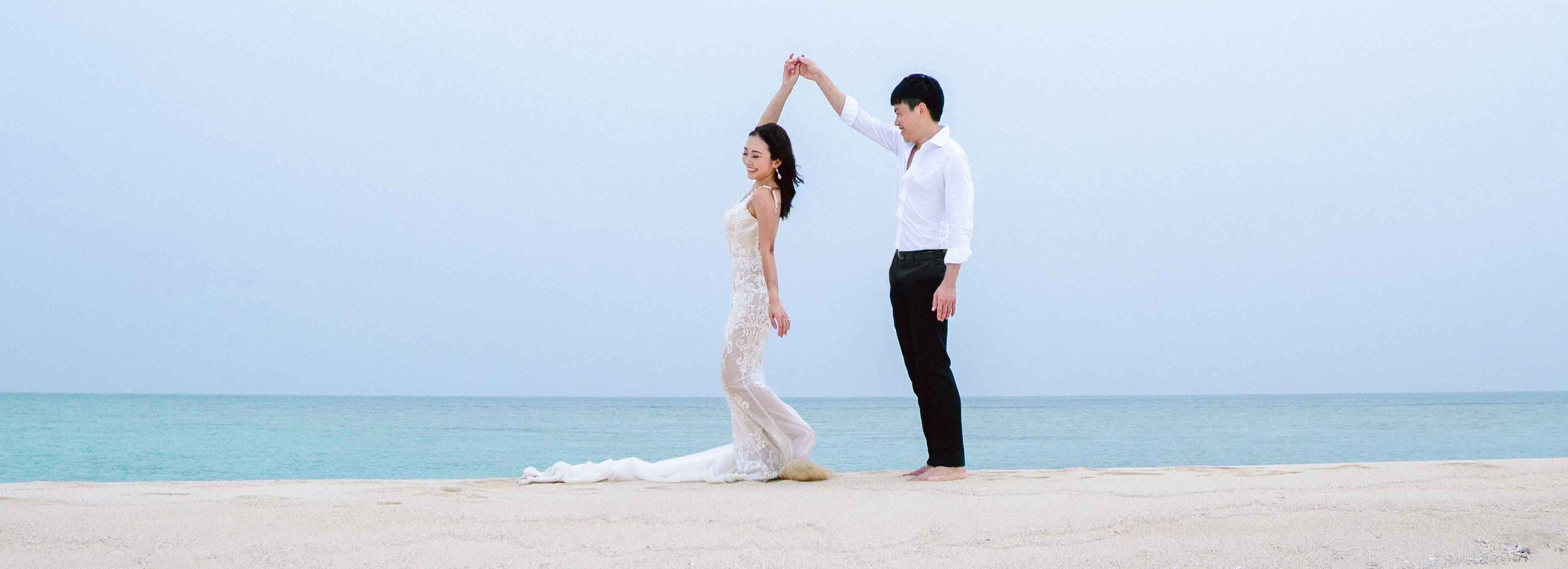 cropped_wedding_couple_dancing_on_the_beach