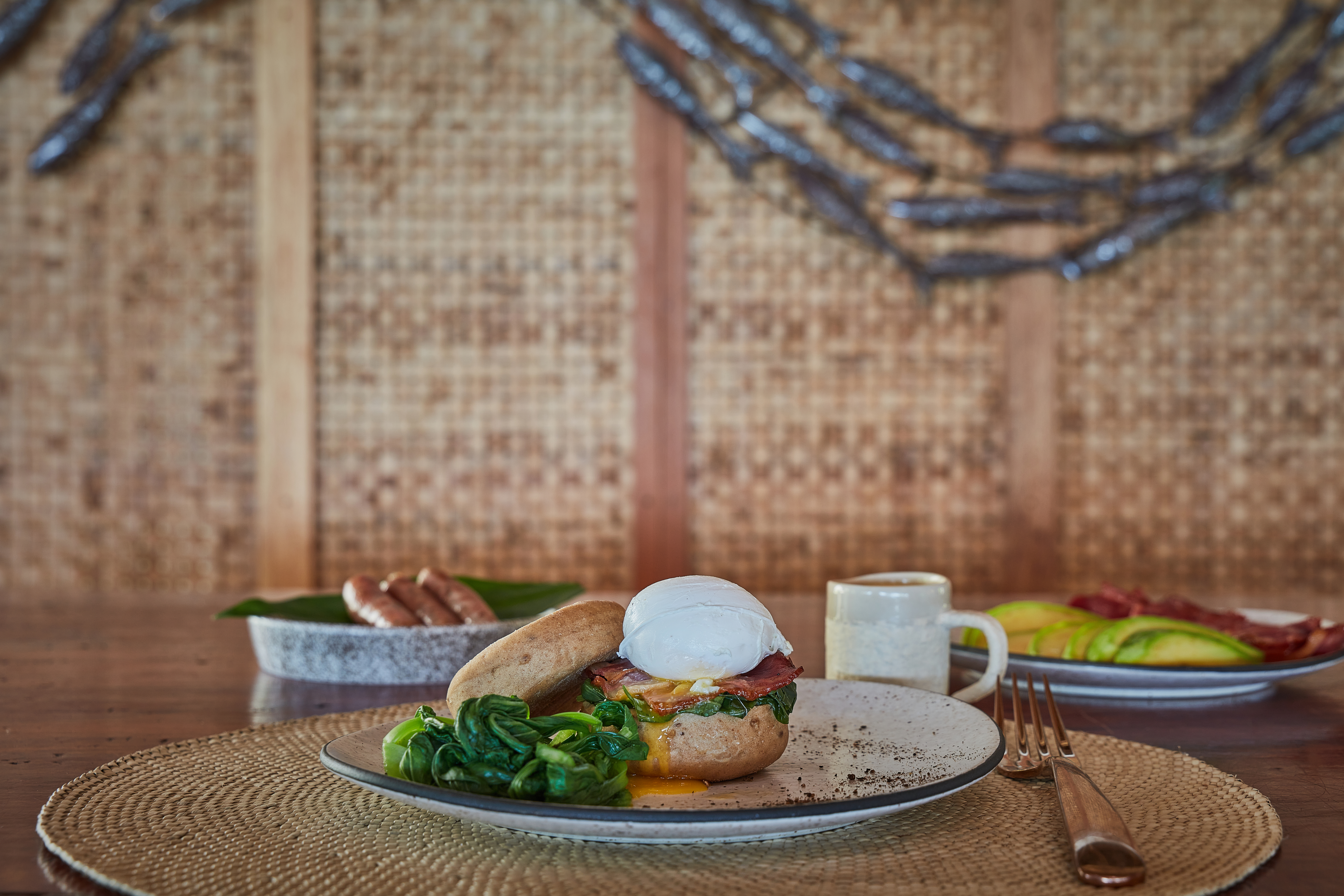eggs_benedict_bacon_and_sausages_served_on_table