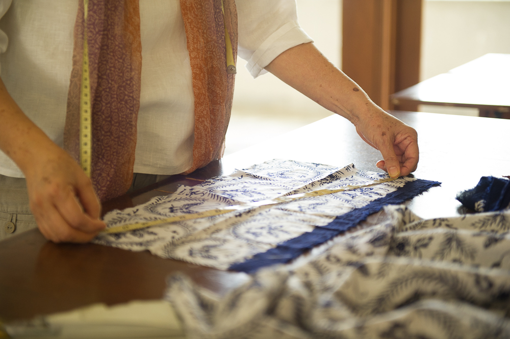 female_fashion_designer_measuring_batik_cloth