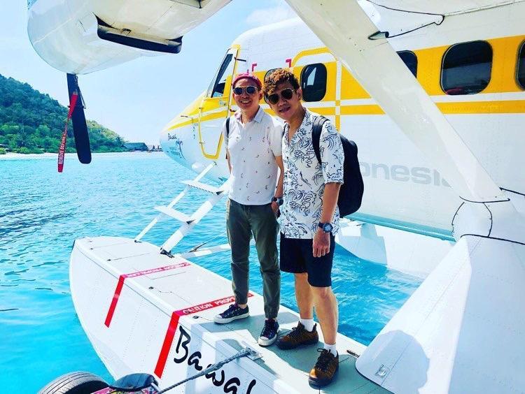 male-couple-standing-on-seaplane-at-jetty